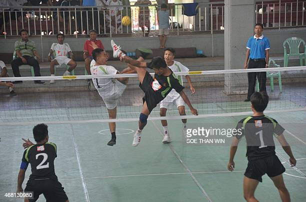 Win Naing of the South Dagon team kicks the ball as Thet Paing Soe of the CNG team blocks the strike during the 4TV Cup match at the Myanmar Sepak...