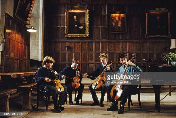 UK, Winchester College, Wiltshire, four boys playing in string quartet