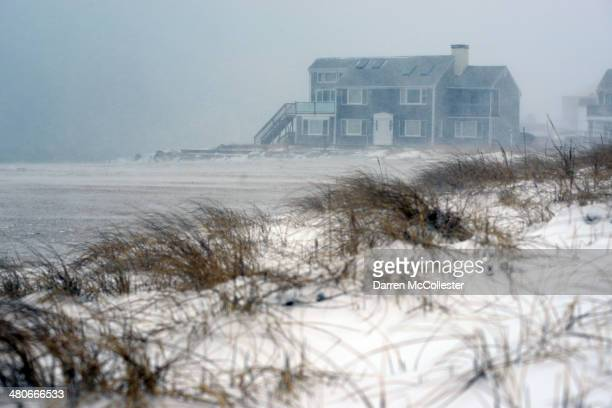 A wind and snow swept beach is seen at Kalmus Park Beach during a snowstorm March 26 2014 in Hyannis Massachusetts An early spring storm brought high...