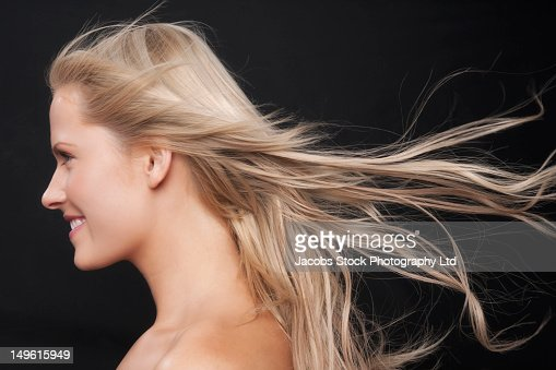 Wind blowing Caucasian woman's hair : Stock Photo