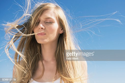 Wind blowing through woman's hair : Stock Photo