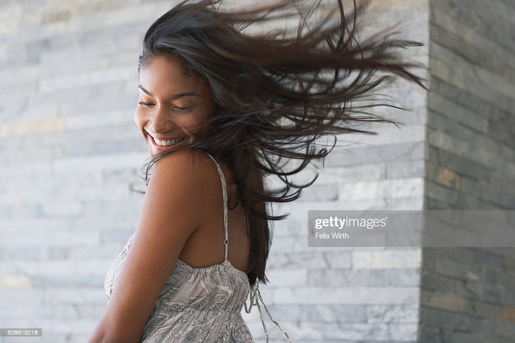 Wind blowing through woman's hair : Stockfoto