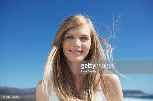 Wind blowing through woman's hair : Bildbanksbilder