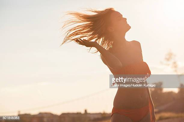 Wind blowing woman's hair with backlight, Drava river, Osijek, Croatia
