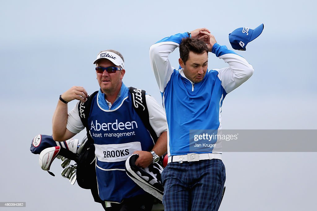 Wind blows the hat off the head of Daniel Brooks of England as he walks with his caddie on the ninth hole during the third round of the Aberdeen...