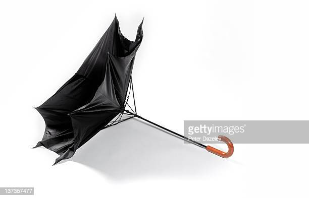 Wind damaged umbrella with copy space