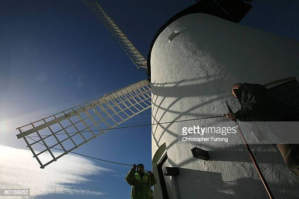 Wind Miller Lloyd Jones and council technical officer John Smith lash down the sails of Melin Llynnon wind mill in preparation for high winds and...
