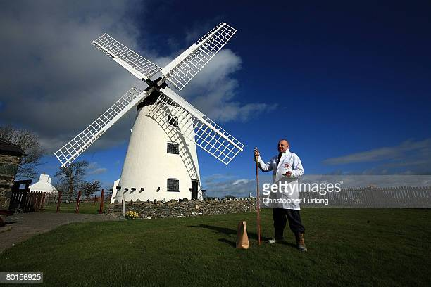 Wind Miller Lloyd Jones poses outside Melin Llynnon windmill where he mills wheat and seed in the traditional way on 7 March near Holyhead Anglesey...