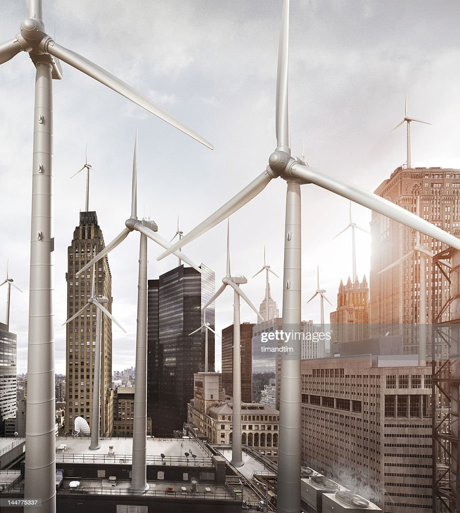 wind mills among buildings in the city : Stock Photo