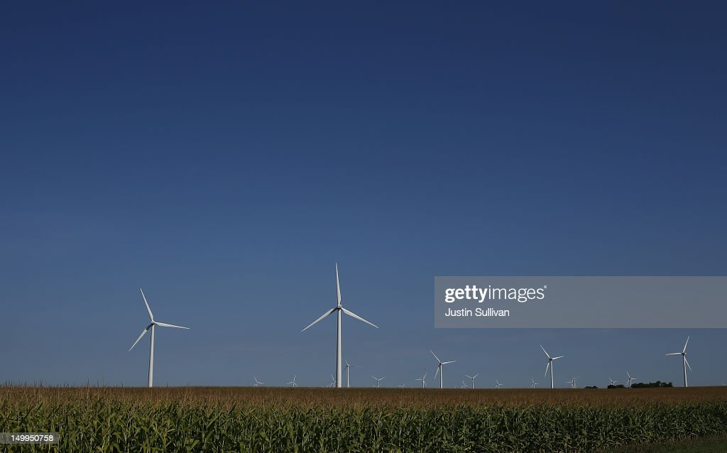 Wind mills are seen in a corn field on August 7, 2012 in Colo, Iowa. An exceptionally hot summer and the worst drought in more than a half century has caused cut prospects for the U.S. corn crop to a five-year low and has sent prices up to over $8.00 a bushel in late July trading. The price surge and limited supply has also prompted ethanol plants to voluntarily slow production by 20 percent, a two year low.