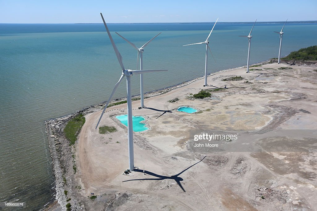 Wind Mills rise over Lake Erie on June 4, 2013 in Lackawanna, New York, near the U.S.-Canada border. The Steel Winds windmill farm, considered one of the largest urban renewable power developments in the world, is located on the grounds of the former Bethlehem Steel Plant. The aerial view was seen from a helicopter flown by the U.S. Office of Air and Marine, (OAM), which monitors and patrols the U.S.-Canada border.
