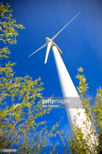 Wind power grnerator against the blue sky