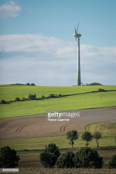 A wind power station on a hill is pictured on August 12 2017 in Oberseifersdorf Germany