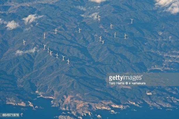 Wind power station on the mountains in Izu Peninsula, daytime aerial view from airplane