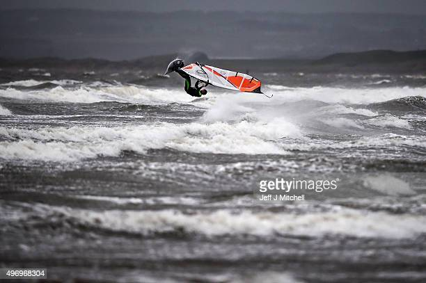 Wind surfer Douglas Paton battles with the weather at Barassie beach on November 13 2015 in Troon Scotland Storm Abigail has closed schools on the...