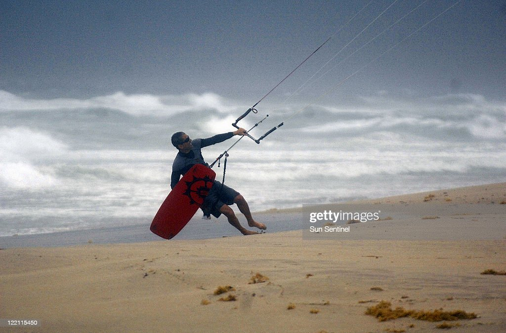 Wind surfer Tom Spitalny struggles with his kite in high winds at Delray Beach, Thursday, August 25, 2011, as Hurricane Irene churns up surf and wind.