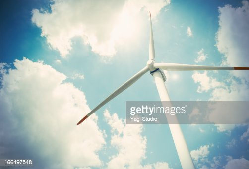 Wind turbine and blue sky, view from below