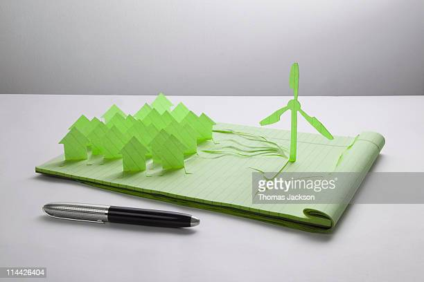 Wind turbine and houses cut from paper