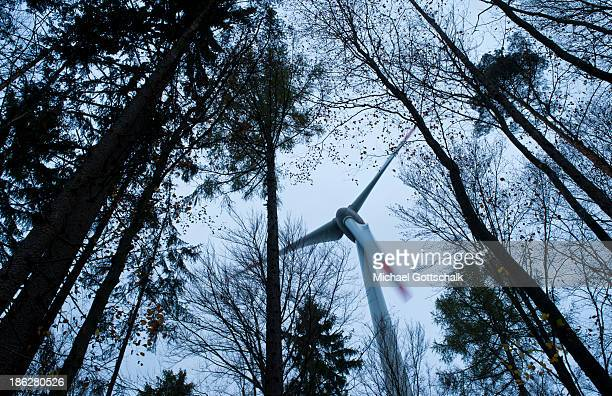 A wind turbine Enercon 101 is located in the forest Brenntenberg behind trees on October 29 2013 in Markt Beratzhausen Germany