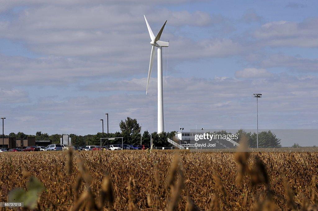 Wind Turbine In Backyard Of Rural High School : Stock Photo