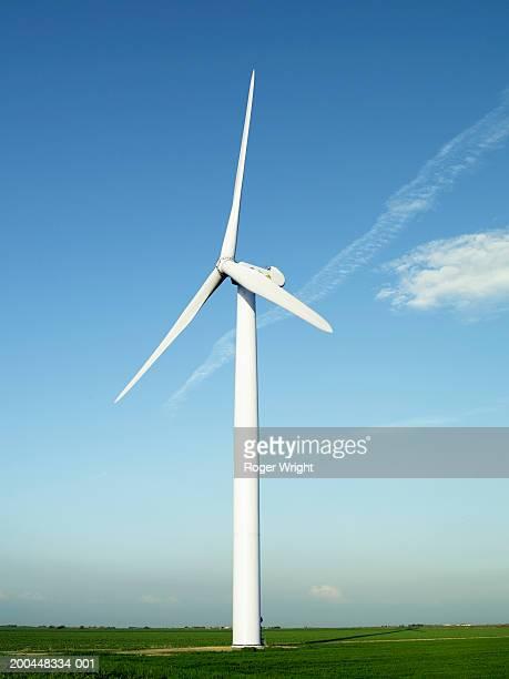 Wind turbine in field, low angle view