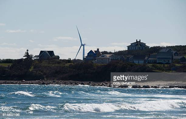 A wind turbine of the Block Island Wind Farm towers above the island on October 14 2016 off the shores of Block Island Rhode Island The first...