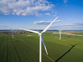 Wind turbine on a field from aerial view. Sustainable development, environment friendly concept. Wind turbine give renewable energy.