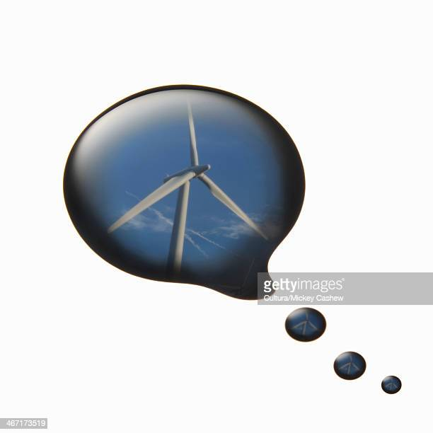 Wind turbine reflected in oil thought bubble