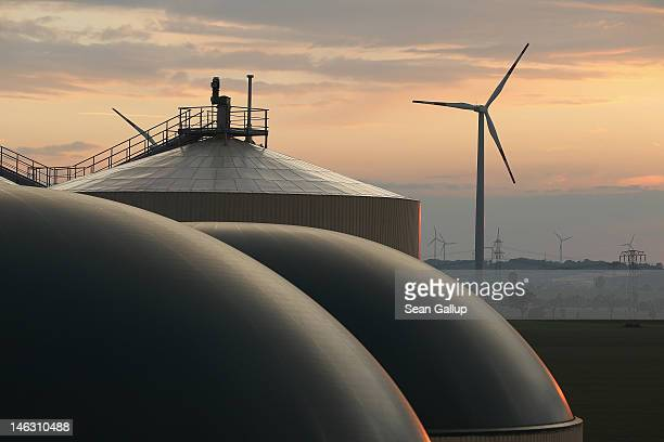 A wind turbine spins behind a new biogas plant in Lower Saxony on June 12 2012 near Ebendorf Germany The plant processes natural waste from local...