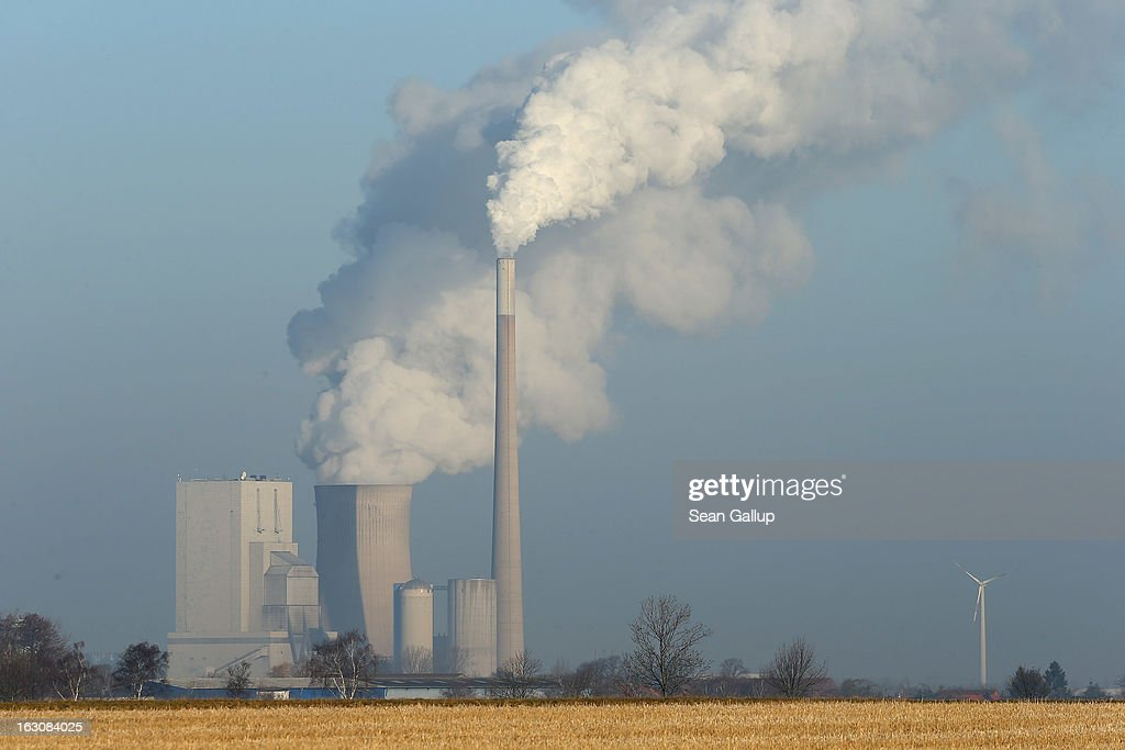 A wind turbine stands near the Mehrum coal-fired power plant (Kohlekraftwerk Mehrum) on March 4, 2013 near Hohenhameln, Germany. German Environment Minster Peter Altmaier and Economy Minister Philipp Roesler rcently proposed a set of measures that would cut subsidies to the renewable energy industry, amove industry representatives claim would stifle renewable energy growth. Germany has set ambitious goals for increasing the renewable energies share of domestic power production, yet critics decry the perceived high cost.
