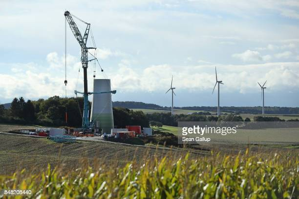 A wind turbine stands under construction on September 14 2017 near Alsfeld Germany Germany is making strong progress in meeting aggressive goals...