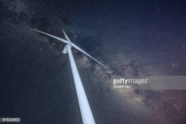 wind turbine under milky way