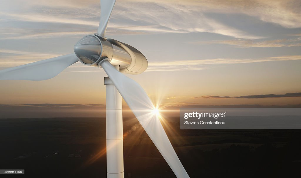 Wind Turbine with lens flare at sunset