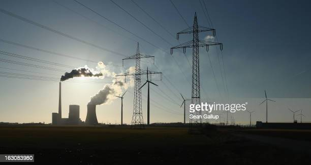 Wind turbines and electricity pylons flank the Mehrum coalfired power plant on March 4 2013 near Hohenhameln Germany German Environment Minster Peter...
