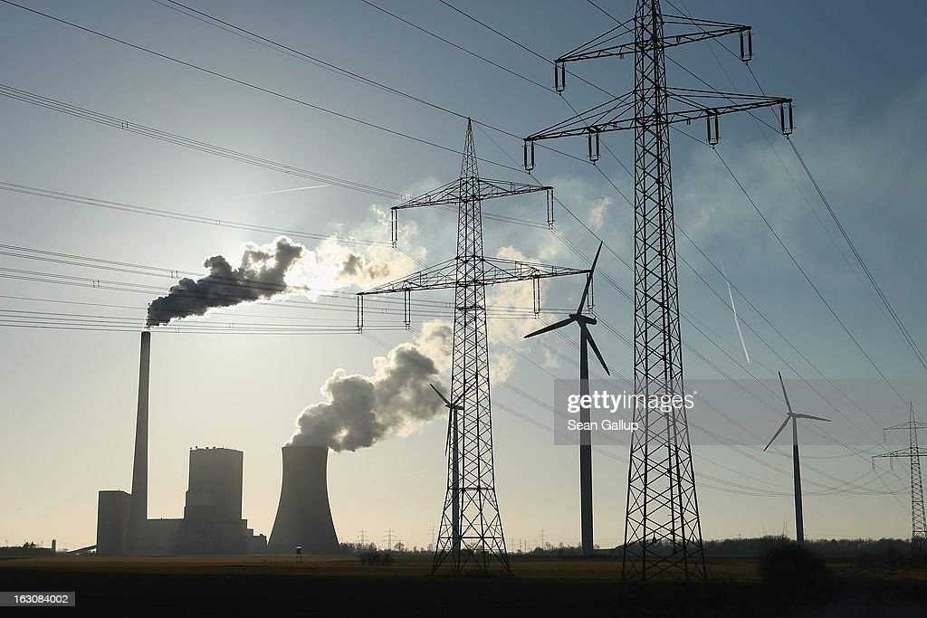 Wind turbines and electricity pylons flank the Mehrum coal-fired power plant (Kohlekraftwerk Mehrum) on March 4, 2013 near Hohenhameln, Germany. German Environment Minster Peter Altmaier and Economy Minister Philipp Roesler rcently proposed a set of measures that would cut subsidies to the renewable energy industry, amove industry representatives claim would stifle renewable energy growth. Germany has set ambitious goals for increasing the renewable energies share of domestic power production, yet critics decry the perceived high cost.