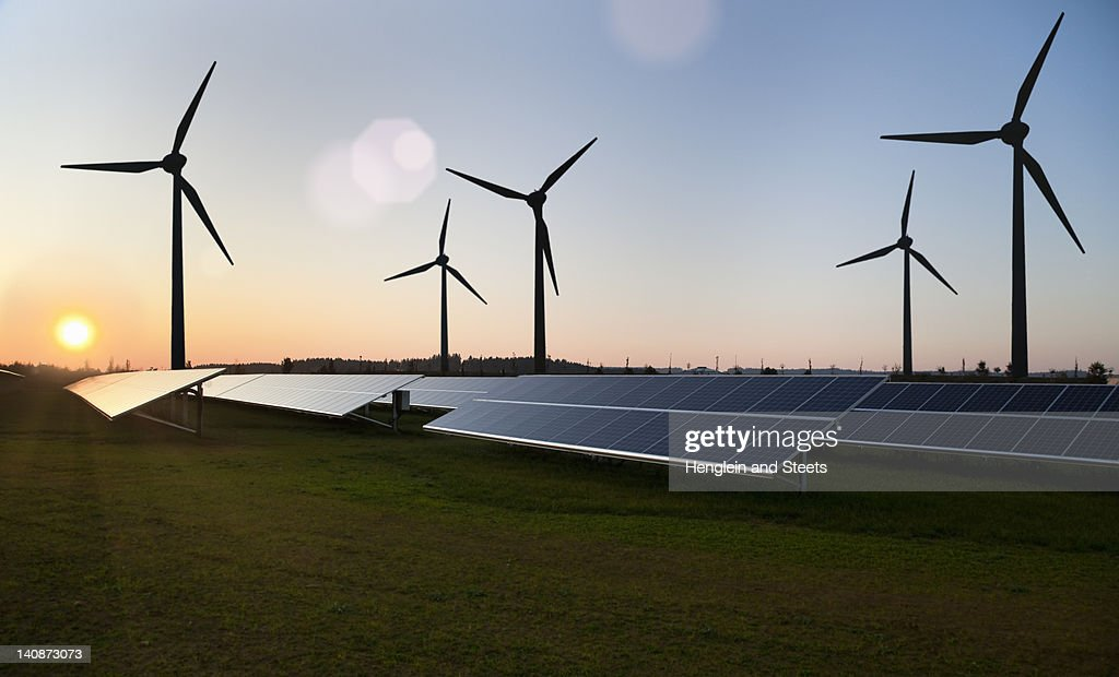 Wind turbines and solar panels in field : Stock Photo