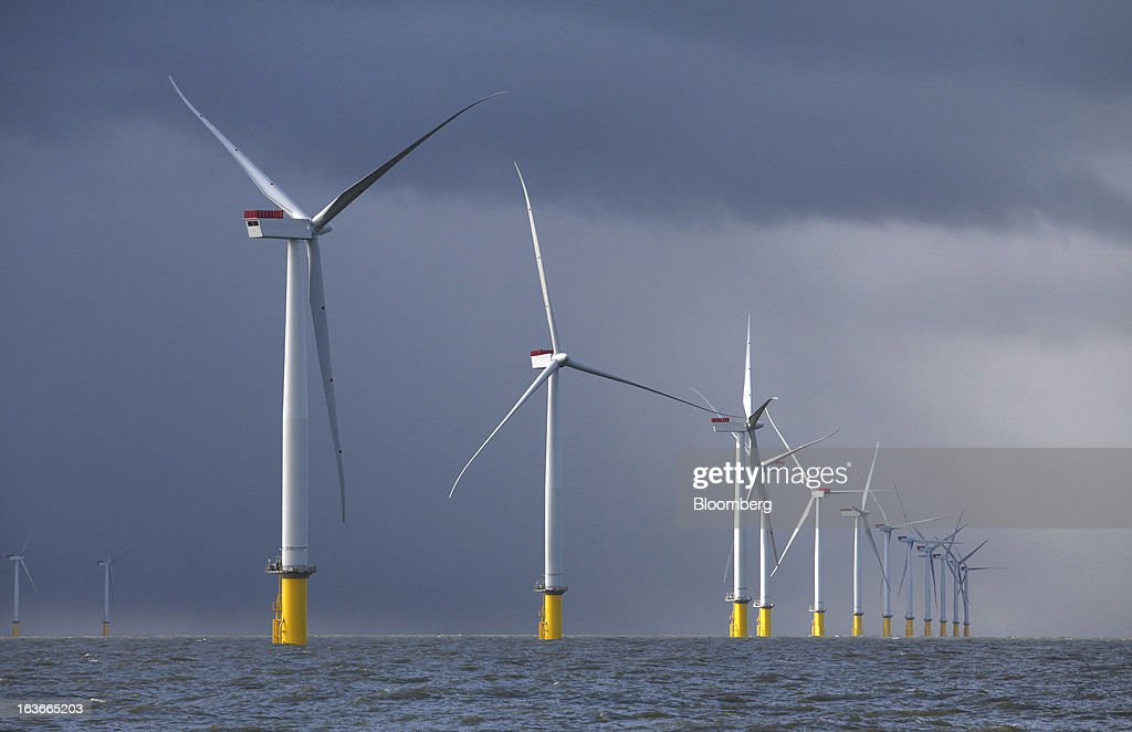 Wind turbines at the London Array project, the world's largest consented wind farm, a partnership between Dong Energy A/S, E.ON AG and Abu Dhabi-based Masdar are seen in the Thames Estuary, U.K., on Wednesday, March 13, 2013. 'London Array will soon be the largest operational offshore wind farm in the world,' said Benj Sykes, head of Dong Energy's U.K. wind business. Photographer: Chris Ratcliffe/Bloomberg via Getty Images