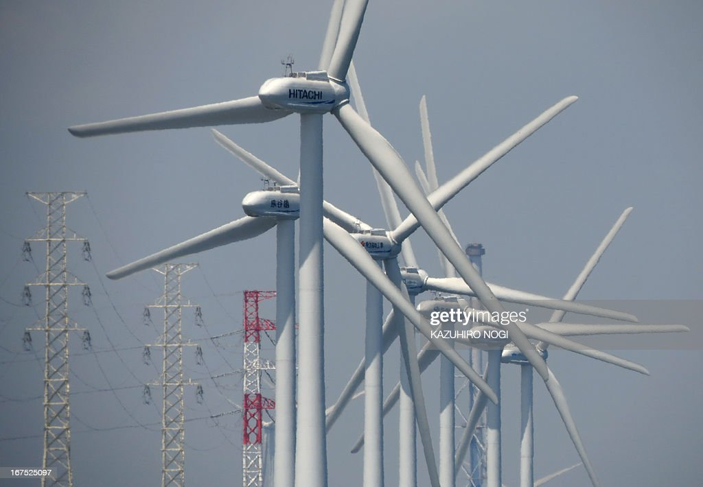 Wind turbines generate electricity at the seaside in Kamisu city, Ibaraki prefecture about 110 kms east of Tokyo on April 26, 2013. As of April 2013, the city has 42 turbines and a total output of 71100 kw.