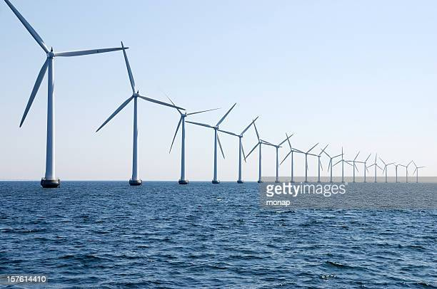 wind turbines in a row at sea outside Copenhagen