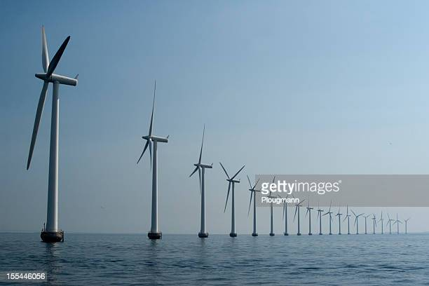 Wind turbines in a row at the ocean outside Copenhagen