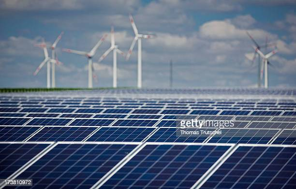 Wind Turbines of an Onshore Wind Farm and Solar panels containing photovoltaic cells at the Solarpark are pictured on July 17 2013 near Grischow...