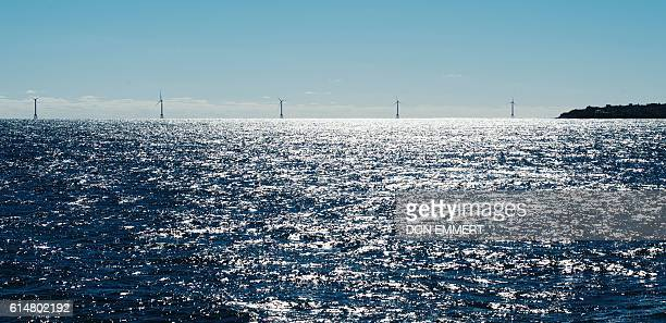 Wind turbines of the Block Island Wind Farm tower above the water on October 14 2016 off the shores of Block Island Rhode Island The first offshore...