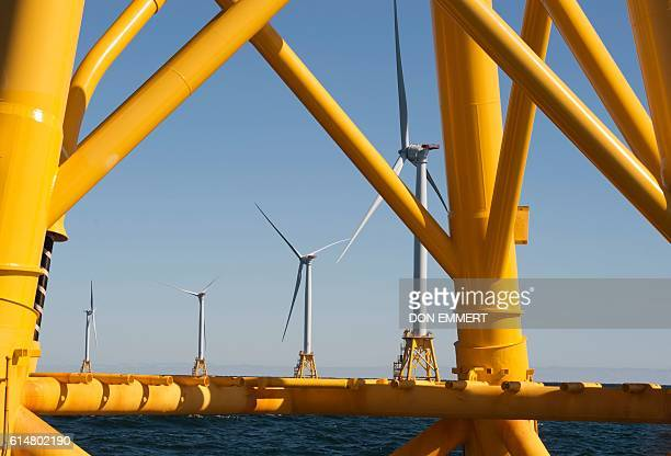 Wind turbines of the Block Island Wind Farm tower over the water on October 14 2016 off the shores of Block Island Rhode Island The first offshore...