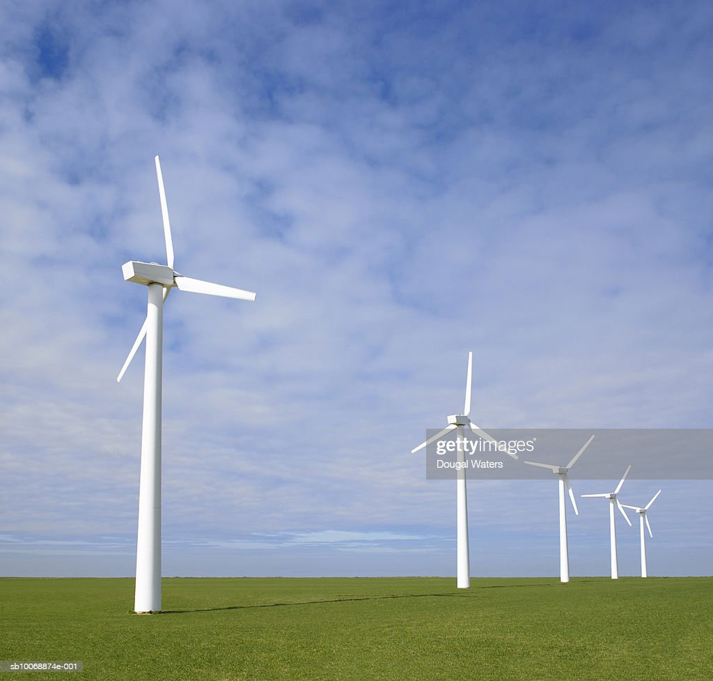 Wind turbines on green landscape : Stock Photo