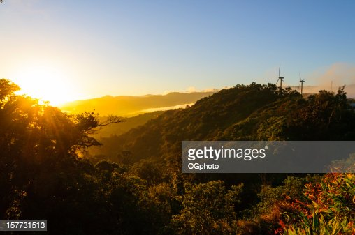 Wind turbines on mountains with early morning sunrise : Stock Photo