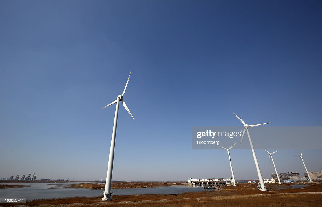Wind turbines operate at the Sino-Singapore Tianjin Eco-city in Tianjin, China, on Wednesday, March 13, 2013. China's money-market rate rose to a one-week high after central bank Governor Zhou Xiaochuan said yesterday the nation should be on 'high alert' over inflation. Photographer: Tomohiro Ohsumi/Bloomberg via Getty Images