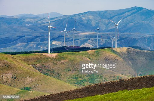 Wind turbines over the Great Wall of China : Stock Photo