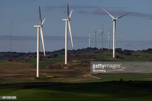Wind turbines stand in green fields at the Barasoain wind energy farm operated by Acciona SA in Navarra Spain on Thursday March 27 2014 The Spanish...