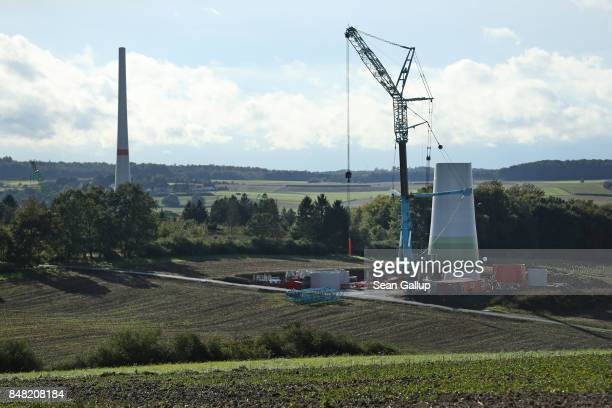 Wind turbines stand under construction on September 14 2017 near Alsfeld Germany Germany is making strong progress in meeting aggressive goals...