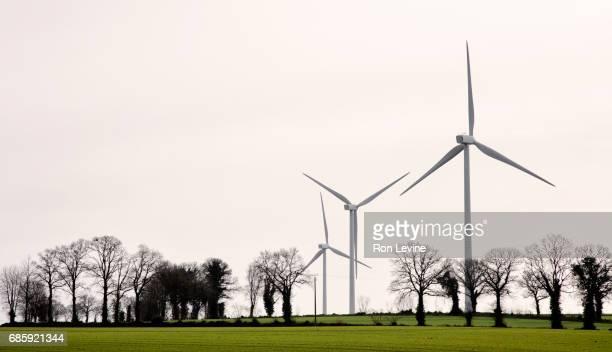 Wind turbines standing in fields